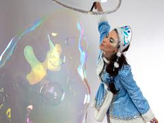 Portrait of snow maiden with long soap bubble - stock photo