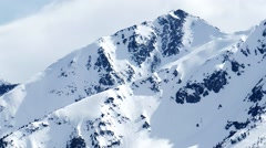 Snow capped Rocky Mountain Peak Stock Footage