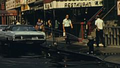 New York 1976: hydrant pumping water in the street - stock footage