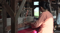 Nyaung Shwe, woman working with silk weaving Stock Footage