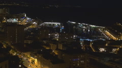 Timelapse aerial view Monaco cityscape night traffic street old harbor bay yacht Stock Footage