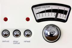 Toaster dial and chrome knobs - stock photo
