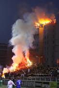 FC Dynamo Kyiv ultra supporters burn flares Stock Photos