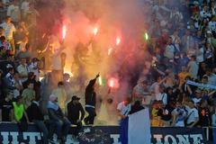 FC Dynamo Kyiv supporters burn the fires Stock Photos