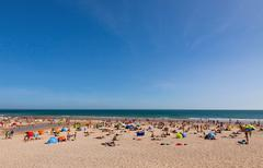 Crowded Atlantic summer beach in Portugal Stock Photos