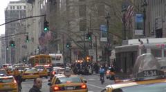 Heavy traffic street busy avenue crowded yellow taxi Manhattan New York city USA Stock Footage
