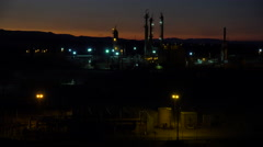 Establishing shots of an oil refinery at night. Stock Footage