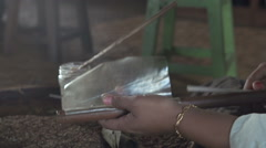 Stock Video Footage of Nyaung Shwe, woman makes cigars