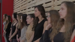 Young girls lined up in a row for the selection of the casting Stock Footage