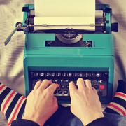 young man typewriting, with a retro effect - stock photo