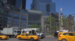 Pan right heavy traffic street Columbus Circle avenue New York City school bus  Stock Footage