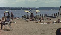 USA 1976: people sunbathing on the beach Stock Footage