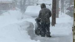Man uses snow blower, snowstorm blizzard Stock Footage