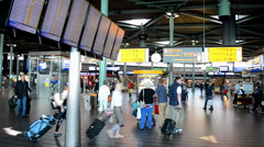 Airport schedule monitor in Amsterdam Airport Schiphol, Amsterdam, Netherlands. Stock Footage