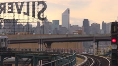Closeup Metro train pass New York City suburban connection Manhattan building US Stock Footage