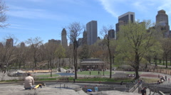 Tourist people relax Central Park New York City Manhattan downtown springtime US Stock Footage
