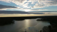 Aerial View at Sunrise over a Winter Lake - stock footage