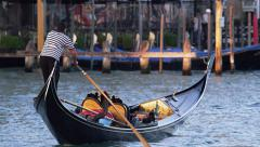 Gondolier Takes Gondola Through the Grand Canal 4K Stock Video Footage - stock footage
