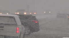 Trucks and cars traffic in heavy snow and blizzard conditions Stock Footage