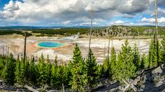 Panoramic view of Grand Prismatic spring in Yellowstone NP - stock photo