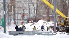 A crane lifts a metal beam Stock Footage