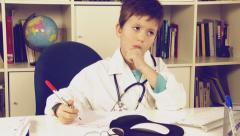 Cute child writing medicine prescription playing doctor thumb up - stock footage