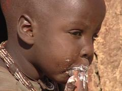 Childrens himba eating Stock Footage
