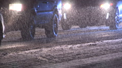 Heavy snow and traffic at night in winter storm Stock Footage