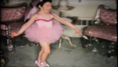 1675 - little ballerina dances new steps at home - vintage film home movie Stock Footage