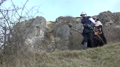 Female Paladin And Hunter walking Mountains - stock footage
