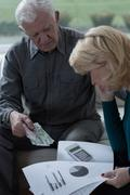 Looking at home budget - stock photo