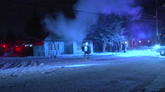 Wide shot of house fire during winter Stock Footage