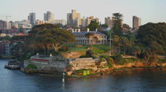 Australia Sydney building with columns on water's edge Stock Footage