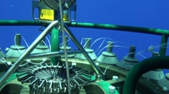 Scientist collecting oceanographic rosette CTD - stock footage