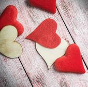 hearts made of felt and wood on the table - stock photo