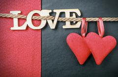 hearts made of felt and the word love made of wood - stock photo