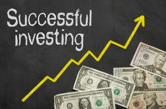 Text on blackboard with money - Successful investing - stock illustration