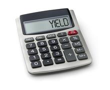 Calculator with the word yield on the display Stock Photos