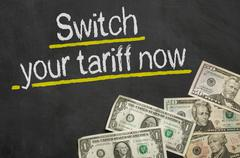 Stock Illustration of Text on blackboard with money - Switch your tariff now
