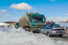 Trucks stopped on highway after heavy snow storm Kuvituskuvat