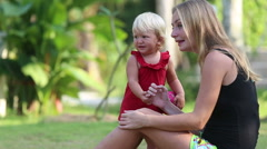 mother shows  interesting to her  blonde daughter - stock footage