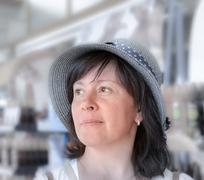 Happy woman in a hat Stock Photos