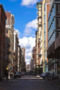 beautiful Green Street in Manhattan with old houses, New York - stock photo