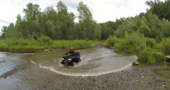 Aerial Stock Footage ATV in mountain river Stock Footage
