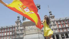 Madrid - Spain people with Spanish flag cheering in front of famous landmark Stock Footage