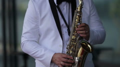 Man playing the saxophone Stock Footage
