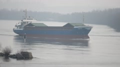 Cargo ship in the fog floats on the channel. Stock Footage