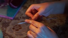 knittng in the evening at home silence lamp hobby - stock footage