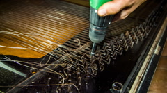 Dismantling Process of Old Piano Strings With Drill - stock footage