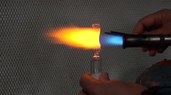 Scientist sealing phials with fire Stock Footage